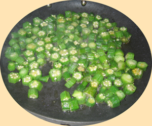 Okra cooking on pan on stove