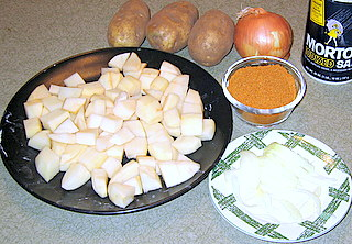 ingredients for potato curry include, onions, potatoes, salt, spices
